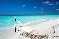 Hammock on tropical beach, Maldives, Indian Ocean, Asia Stock Photo - Premium Rights-Managednull, Code: 841-07082745