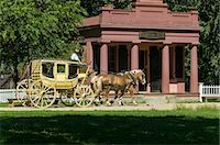 Horse drawn stagecoach at Old Sturbridge Village, a living history museum depicting early New England life from 1790 to 1840 in Sturbridge, Massachusetts, New England, United States of America, North America Stock Photo - Premium Right