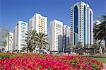 Contemporary architecture and Al Markaziyah Gardens and Fountain, Abu Dhabi, United Arab Emirates, Middle East