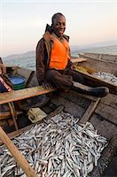 Fisherman on Lake Tanganyika early morning fishing for cichlids to sell in the local fish market, Zambia, Africa Stock Photo - Premium Rights-Managednull, Code: 841-07084355