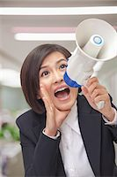 Young Businesswoman with Megaphone Stock Photo - Premium Royalty-Freenull, Code: 6116-07084859