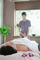 foot massage - Woman Receiving Foot Massage Stock Photo - Premium Royalty-Freenull, Code: 6116-07085758