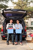 Father and son unpacking car for college Stock Photo - Premium Royalty-Freenull, Code: 6116-07086139
