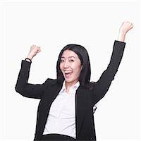 Businesswoman cheering Stock Photo - Premium Royalty-Freenull, Code: 6116-07086341