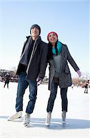 Young couple skating at ice rink Stock Photo - Premium Royalty-Freenull, Code: 6116-07086567