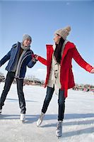 Young couple skating at ice rink Stock Photo - Premium Royalty-Freenull, Code: 6116-07086568