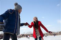 Young couple skating at ice rink Stock Photo - Premium Royalty-Freenull, Code: 6116-07086570