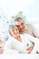Portrait of a happy senior couple looking at camera and smiling Stock Photo - Royalty-Freenull, Code: 400-07096201