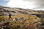 Man speed hiking in rocky landscape, Norway, Europe