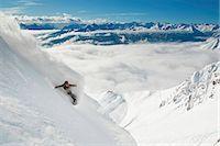 Snowboarder takes a powder turn, Innsbruck, Austria Stock Photo - Premium Royalty-Freenull, Code: 6115-07109803