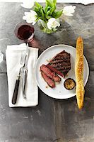 fork - Overhead View of Steak with Spicy Mustard and Breadstick, Studio Shot Stock Photo - Premium Royalty-Freenull, Code: 600-07110687