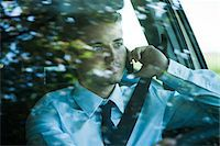 Businessman using Cell Phone and Driving, Mannheim, Baden-Wurttemberg, Germany Stock Photo - Premium Royalty-Freenull, Code: 600-07110825