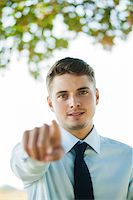 Portrait of Businessman Pointing at Camera, Mannheim, Baden-Wurttemberg, Germany Stock Photo - Premium Royalty-Freenull, Code: 600-07110832