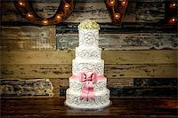 Image of a beautiful wedding cake with a rustic background Stock Photo - Royalty-Freenull, Code: 400-07111195