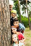Portrait of group of children posing next to tree in park, Germany Stock Photo - Premium Royalty-Free, Artist: Uwe Umstätter, Code: 600-07117117