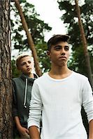 Portrait of two boys standing next to tree in park, Germany Stock Photo - Premium Royalty-Freenull, Code: 600-07117124