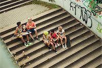 preteen girl - Overhead view of group of children sitting on stairs outdoors, Germany Stock Photo - Premium Royalty-Freenull, Code: 600-07117161
