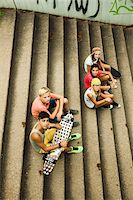 Group of children sitting on stairs outdoors, looking up at camera, Germany Stock Photo - Premium Royalty-Freenull, Code: 600-07117162