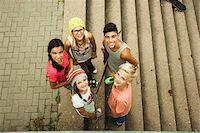 Group of children standing outdoors on cement staris, looking up at camera, Germany Stock Photo - Premium Royalty-Freenull, Code: 600-07117165