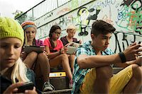 Group of children sitting on stairs outdoors, using tablet computers and smartphones, Germany Stock Photo - Premium Royalty-Freenull, Code: 600-07117168