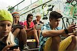 Group of children sitting on stairs outdoors, using tablet computers and smartphones, Germany Stock Photo - Premium Royalty-Free, Artist: Uwe Umstätter, Code: 600-07117168