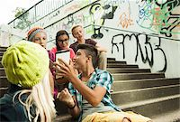 Group of children sitting on stairs outdoors, using tablet computers and smartphones, Germany Stock Photo - Premium Royalty-Freenull, Code: 600-07117170