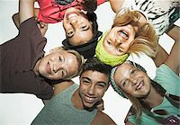 Group of children in circle, smiling and looking down at camera, Germany Stock Photo - Premium Royalty-Freenull, Code: 600-07117182