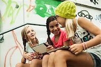 preteen girl pigtails - Girls Sitting on Steps with Tablet Computers, Mannheim, Baden-Wurttemberg, Germany Stock Photo - Premium Royalty-Freenull, Code: 600-07117285