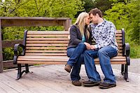 Young Couple on Park Bench, Scanlon Creek Conservation Area, Bradford, Ontario, Canada Stock Photo - Premium Rights-Managednull, Code: 700-07117264