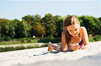 preteen bathing suit - Girl using Cell Phone at Beach, Lampertheim, Hesse, Germany Stock Photo - Premium Royalty-Freenull, Code: 600-07117302