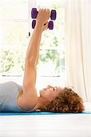 Woman Lifting Dumbbells Stock Photo - Premium Rights-Managednull, Code: 822-07117379