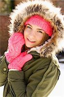 Smiling Teenage Girl Wearing Hooded Parka Outdoors Stock Photo - Premium Rights-Managednull, Code: 822-07117419