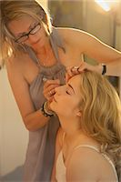 Make up Artist Applying Eyeliner on Teenage Girl Stock Photo - Premium Rights-Managednull, Code: 822-07117447