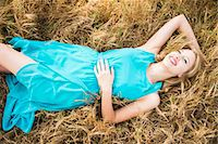 Smiling Woman Lying in Grass Stock Photo - Premium Rights-Managednull, Code: 822-07117503