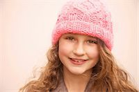 Smiling Young Girl Wearing Pink Wool Hat Stock Photo - Premium Rights-Managed, Artist: ableimages, Code: 822-07117549