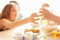 Girls Toasting Around Table, Close-up View Stock Photo - Premium Rights-Managednull, Code: 822-07117570