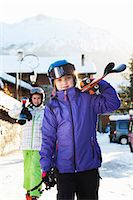 Two sisters carrying skis, Villaroger, Haute-Savoie, France Stock Photo - Premium Royalty-Freenull, Code: 649-07118120