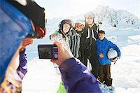 Girl photographing family, Les Arcs, Haute-Savoie, France Stock Photo - Premium Royalty-Freenull, Code: 649-07118125