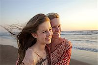 Mother and daughter looking into distance Stock Photo - Premium Royalty-Freenull, Code: 649-07118153