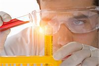 Close up of scientist pouring liquid into test tube Stock Photo - Premium Royalty-Freenull, Code: 649-07118200
