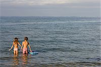 preteen swimsuit - Brother and sister paddling in sea Stock Photo - Premium Royalty-Freenull, Code: 649-07118654