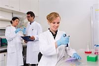 results - Group of scientists working in laboratory. Pipetting solution into microtiter plate (front), discussing bacterial growth on petri dish (back) Stock Photo - Premium Royalty-Freenull, Code: 649-07118830