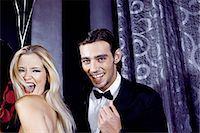 flirting - Young couple having fun in nightclub Stock Photo - Premium Royalty-Freenull, Code: 649-07118889