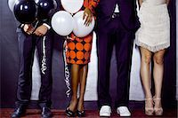 queue club - Waist down shot of group of friends with balloons Stock Photo - Premium Royalty-Freenull, Code: 649-07118891