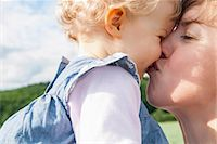 Mother kissing daughter Stock Photo - Premium Royalty-Freenull, Code: 649-07118981