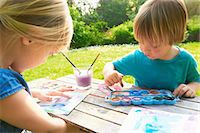 finger painting - Brother and sister finger painting in garden Stock Photo - Premium Royalty-Freenull, Code: 649-07119205