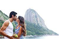 Couple kissing on beach with Sugarloaf Mountain, Rio de Janeiro, Brazil Stock Photo - Premium Royalty-Freenull, Code: 649-07119653