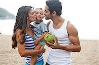 Family on beach, mother kissing son on cheek Stock Photo - Premium Royalty-Freenull, Code: 649-07119663