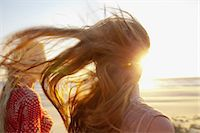 Mother and daughter on windy beach, close up Stock Photo - Premium Royalty-Freenull, Code: 649-07119731