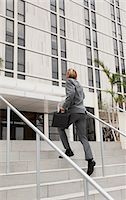 businessman climbing stairs Stock Photo - Premium Royalty-Freenull, Code: 6106-07119958